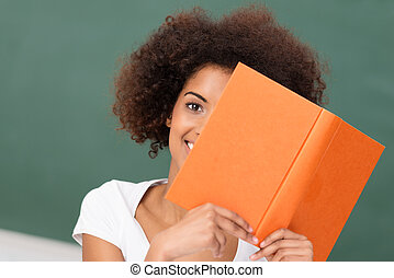 African American woman reading a book