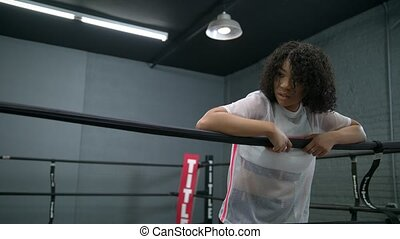 African American woman resting in the ring