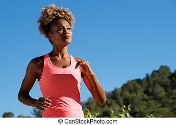 African american woman runner jogging outdoors