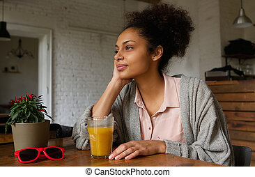 African american woman sitting at home thinking