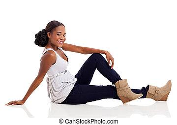 african American woman sitting on floor