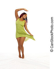 African American Woman Smiling In Green Dress