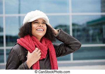 African american woman smiling in winter clothes