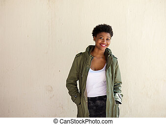 African american woman smiling with green jacket