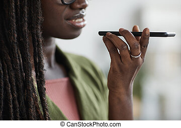 African-American Woman Speaking by Smartphone Close Up