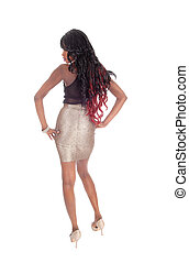 African American woman standing from back.