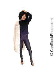 African American woman standing in fur coat.