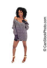 African American woman standing in sweater.