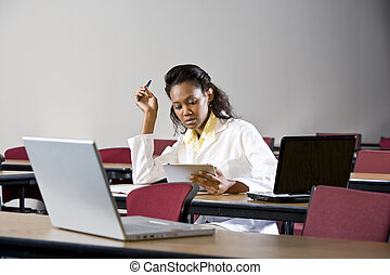 African American woman studying in classroom