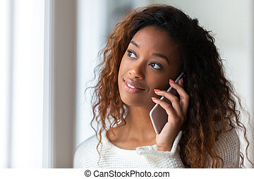 African American woman talking on a mobile phone - Black people