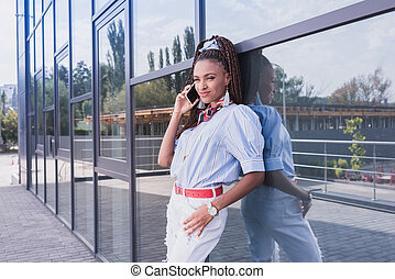 african american woman talking on phone outside