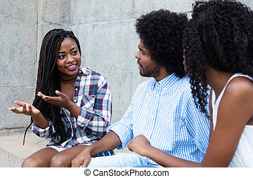 African american woman talking with friends