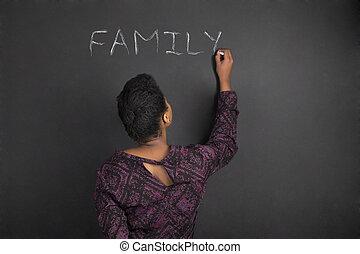 African American woman teacher writing family