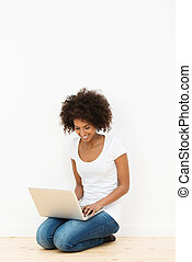 African American woman using her laptop