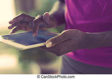 african american woman using tablet