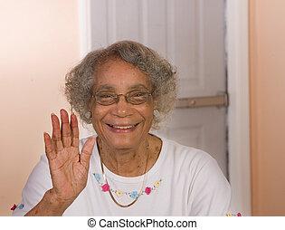 African American Woman Waving - African American senior...