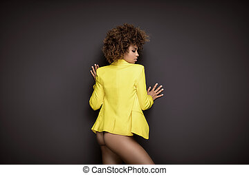 African american woman with afro hairstyle posing.
