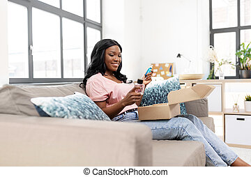 african american woman with cosmetics at home