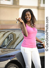 african american woman with her new car