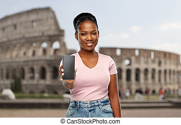 african american woman with smartphone at coliseum