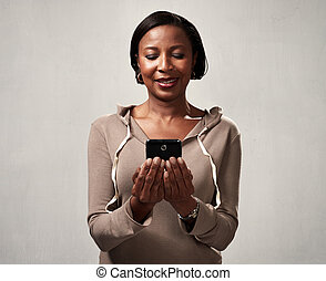 African american woman with smartphone