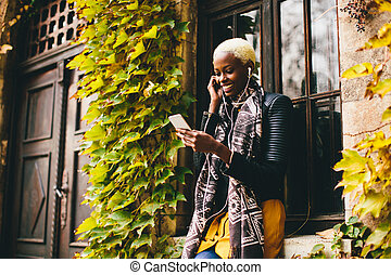 African american woman with smartphone outdoor