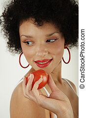 African american woman with tomatoe