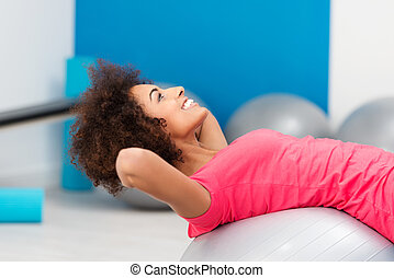 African American woman working out in the gym