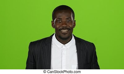 African american wonderful guy, his smile conquers all, and laughter is contagious. Green screen. Close up