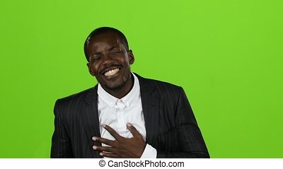 African american wonderful guy, his smile conquers all, and laughter is contagious. Green screen. Slow motion