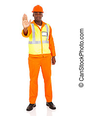 african american worker with stop gesture