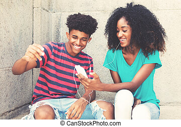 African american young adult couple loves music