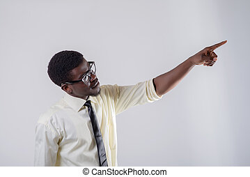 young man points his index finger