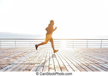 African american young man running in the morning