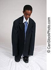 African americna boy dressed as businessman