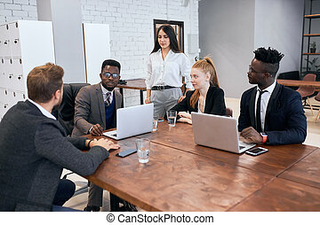 African and caucasian businees people gathered in meeting
