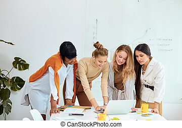 African and caucasian women coworking in office