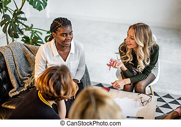 African and caucasian women meet at studio, after couch training session