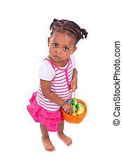 African Asian girl holding chocolate ester egg