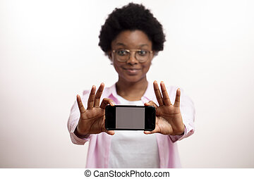 african awesome woman showing a new model of a smartphone