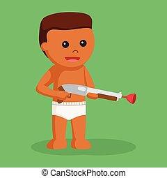 African baby boy with shotgun toy