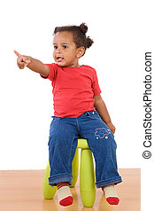 African baby sitting on a stool