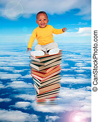 African baby sitting on stack of books