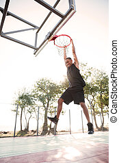 African basketball player practicing outdoors