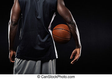 African basketball player with a ball in his arm