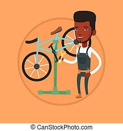 African bicycle mechanic working in repair shop. -...