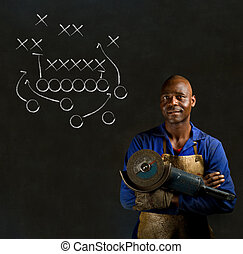 African black man industrial worker with chalk game plan