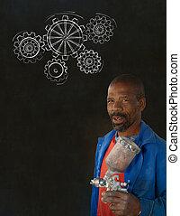 African black man industrial worker with chalk gears blackboard