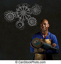 African black man industrial worker with chalk gears