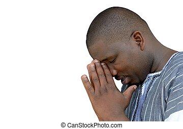 African black man praying - South African black young man...